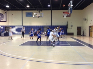 Cougar number 3, Jacque Scott, scores two points for her team in period one. By Nicole Baus, CCC Journalism Program