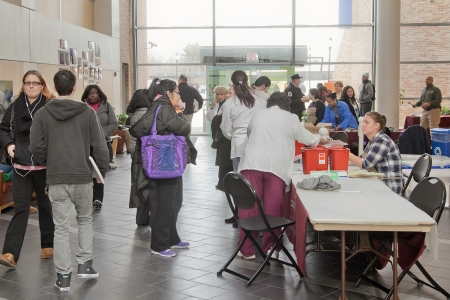 Students wait to receive free flu shots provided by the Camden County Board of Health at Camden County College, Blackwood NJ Campus.