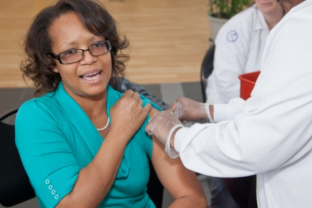Tanya Mansuy, office of information technology, Camden County College, receives a flu shot during the flu shot drive held at the Connector Building at the Blackwood campus on 7 February 2013.