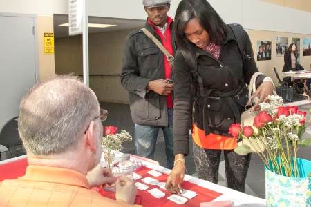 Feb. 14. Camden County College students Geoffrey Jones (L) and Amira Sallie (R) purchase roses at the connector building.