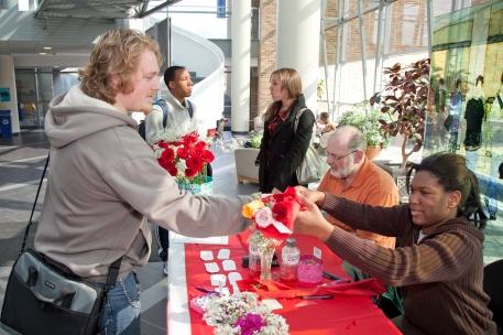Feb. 14. Student Nick Long (L) purchases roses from Autumn Edwards.