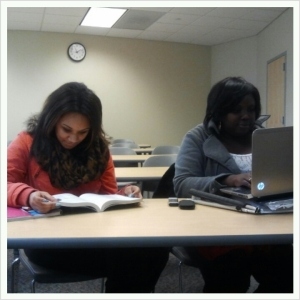 Students Austin Harman (left) and Sydarra Coats study and add last-minute touches to a research paper. By Robin Hester, CCC Journalism Program
