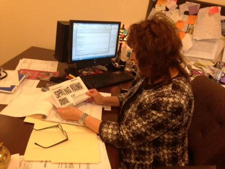 Jackie Tenuto, assistant to the executive dean at Camden County College, reads the flyer for the 2013 Spring Fling. By Heather Tomafsky, CCC Journalism Program