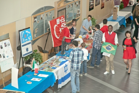 Students set up tables for International Day 2013 at Camden County College, Blackwood Campus.
