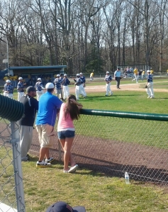 Spectators look on as the Camden County College men's baseball team gives each other high fives after an eight-run second inning. By Angel Nogueras, CCC Journalism Program