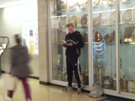Defenseman Daniel Feiser of the men's soccer team looks over his assignments before going to class. By Chris O'Grady, CCC Journalism Program