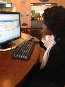 Mere'Line Green, a student, tries to navigate WebStudy. By Essence Money, CCC Journalism Program
