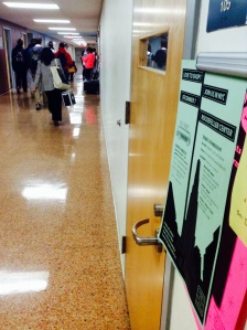 The campus' corridors are filled with posters about the bus trip to New York's Rockefeller Center. By Natalia Panfilova. CCC Journalism Program