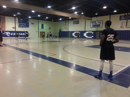 Shakoor Woodson (25) looks on as his teammates practice. By Anna Tsiaras, CCC Journalism Program