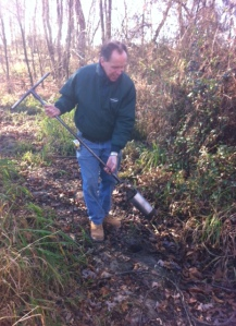 In Pittsgrove, New Jersey, Mark Muraczewski, an employee of Pennoni Associates, digs up soil in order determine whether the area can be considered wetlands.