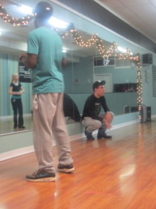 Mr. Seth Jones, Miss Jones son assisting with an intermediate Hip Hop class at the dance studio. Here Jones is helping to correct and critique the students while, the instructor teaches the new combination to the students.