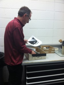 Professor Frederick Herr looks over students' finished prints. By Rachel Foster, CCC Journalism Program