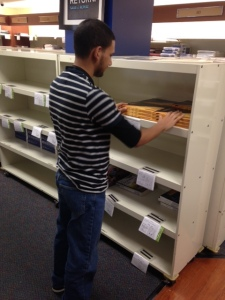 Charles Nieves, student and employee at the Camden County College Bookstore, keeps everything organized at work. By Maria Gomez, CCC Journalism Program