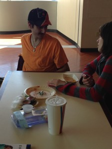 Students Nick Hall and Colleen Devine enjoy a cafeteria lunch. By Angel Malone, CCC Journalism Program