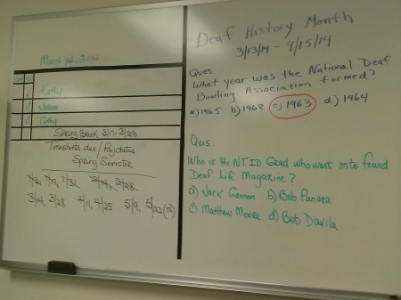 Payroll reports and notes are written on a board. By Noreen Peebles, CCC Journalism Program