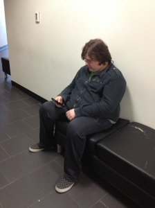 Ian Stabler uses his cellphone between classes. By Jonathan Rones, CCC Journalism Program