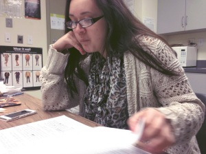 Ms. Christine Parker, 18, is pictured studying for an upcoming chemistry test. While on her lunch break, she is trying to finish some schoolwork before the weekend ends.