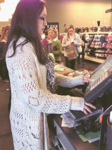 Pictured is Ms. Christine Parker, 18, ordering a customer's (no name given) shoes online at DSW in Marlton, NJ. Ms. Parker is taking down the customer's information so that way the customer can receive her shoes on time.