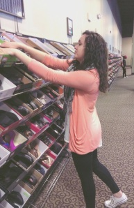 Ms. Christine Parker, 18, is photo'd fixing shoes in the clearance section at DSW in Marlton, NJ. Intending that she is doing her job efficiently, Ms. Parker goes through every box in the section to make sure the shoes are perfect.