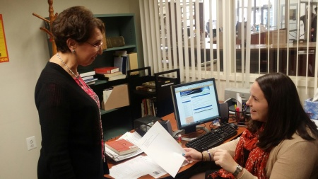 Samantha Kennedy(right) talks business with Library Director Barbara Laynor (left). By Don Atkinson, CCC Journalism Program