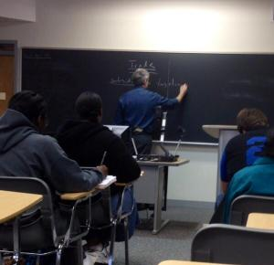 Dr. Patrick Hughes lectures in the international relations class. By Chelsea Coccia, CCC Journalism Program