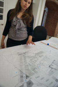 Diana Fernandez explaining a current project her firm is working on, as part of a park for William Dick Elementary School in Philadelphia. As a landscape designer she inputs ideas of how the project should look. The sketches in her hand are illustrating how and where the trees in the park should be.  This is taking place in the office of Sikora Wells Appel in Haddonfield New Jersey on April 16, 2014 during 2:32 pm.
