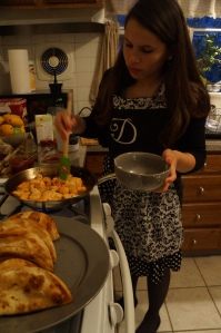"""After a long day at work, Diana Fernandez makes dinner for her boyfriend, Devin Bibeau, and her daughter. She is sautéing chicken for the tacos she is making. This picture is taken in her kitchen in her duplex apartment in Haddonfield New Jersey on April 16, 2014 at 7:47pm.  She stated that """"I moved closer to work so that my job takes me serious about how invested I am to my job""""."""