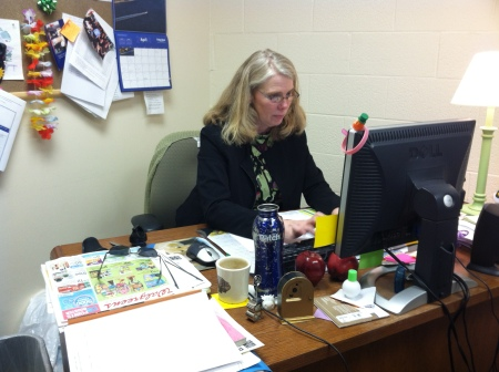 Bernadette Gismonde works in her office. By Rachel Foster, CCC Journalism Program