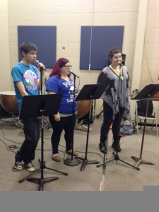 Singers Dave Chorzelewski, Cassie Foster and Alyssa Ford rehearse for the History of Rock 'n' Roll event coming up on April 21. By Maria Gomez, CCC Journalism Program