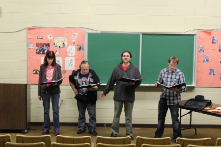 "The cast of ""The Beats Go On"" practice the poem ""America"" during a rehearsal in Truman Hall Room 105. By Will Hoheisel, CCC Journalism Program"