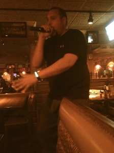 "Regina DeSabatino Applebee's night manager Tom lights up the singing stage! He dances around Applebee's singing ""Baby got Back"" and puts smiles on everyone in Applebee's! He definitely see the stage for upcoming, brave, singers!"