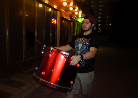 All For One begins to prepare for the stage by loading in all their equipment. Pictured is drummer, Joseph Turchi.