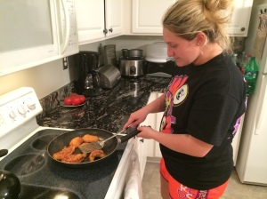 Taylor is an only child, and her parents both work full time jobs. They are not always home on time for dinner, so sometimes Taylor must cook dinner for herself and her family. Here she is cooking chicken cutlets for herself, her mother, and her father.