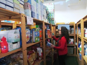 Sonia is going through donations of cereal in the RMHSNJ's pantry. Everything from soap to pasta gets donated.