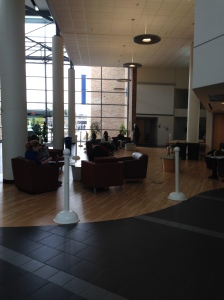 Students sit in the atrium where the open house will be held on April 5. By Angel Malone, CCC Journalism Program