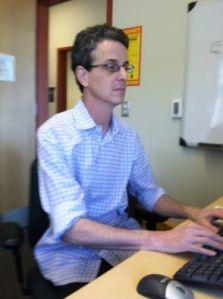 David Nugiel works in his office in Halpern Hall. By Avery Merrick, CCC Journalism Program