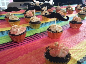 """A close-up shot of Jess Ercolino's """"Cocoa Diablo"""" cupcakes on display at her table."""