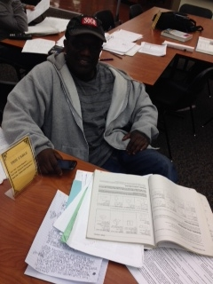 Tim Holmes tutors students at Camden County College. By Elisa Polanco, CCC Journalism Program