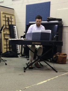 Professor Michael Billingsley rehearses at his keyboard. By Rachael Williamson, CCC Journalism Program
