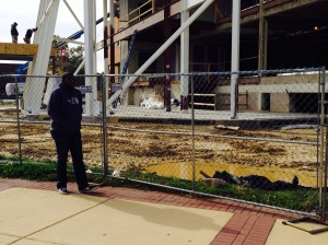 Terrence Jenkins walks past Taft Hall construction. By Alana Brown, CCC Journalism Program