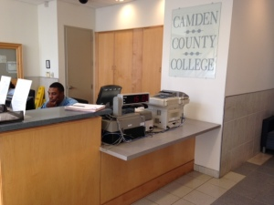 Security Officer Korey Crosby assists in matters related to parking while working the Camden City campus concierge desk
