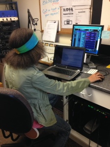 DJ Hippie, a first-semester disc jockey at WDBK, conducts her afternoon radio show. By Brittany Cook, CCC Journalism Program.