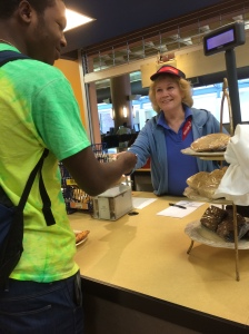 From left, Freshman Quentin Graves and cashier Jean LaPento make a transaction at the Cyber Café.