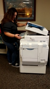 Lydia Perez, Camden County College student, uses the campus library's printer. By Taryn Lawlis, CCC Journalism Program.