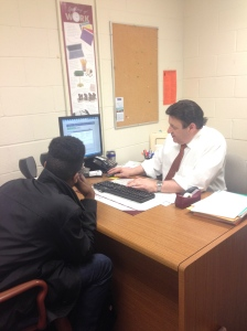 Joe Pranzatelli helps Dominic Henry create a more detail-oriented resume. By Heaven Gallagher, CCC Journalism Program.