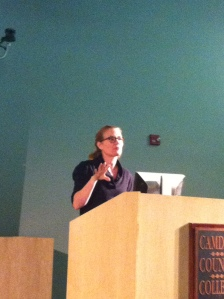 Emily Raabe engages the audience during a reading of one of her poems. By Sam Arcaini, CCC Journalism Program.