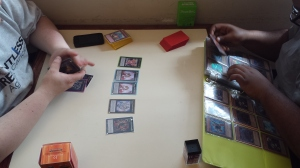 Two students play a game of Yu-Gi-Oh. By Terrence Jenkins, CCC Journalism Program