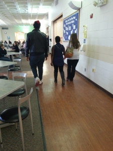 A male and two female students walk down the cafe. By Victor Minnone, CCC Journalism Program