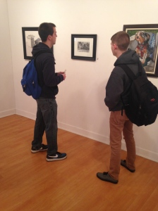 Tom Simber and Nick St. Clair look at their classmates' artwork at the show. By Julie Costa, CCC Journalism Program