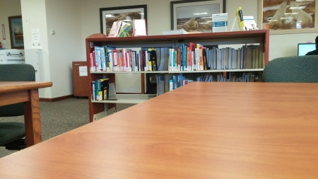 Books, like these on the first floor of the Camden County College library in Blackwood, won't be disappearing, the library's director says. By Anthony Stevenson, CCC Journalism Program